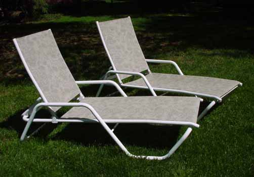 Lounge chairs done in a beautiful foliage pattern.
